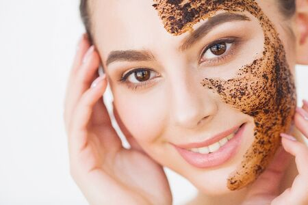 Foto de Face Skincare. Young Charming Girl Makes a Black Charcoal Mask on Her Face - Imagen libre de derechos