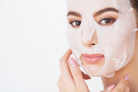 Photo pour Spa Woman applying Facial cleansing Mask. Beauty Treatments - image libre de droit