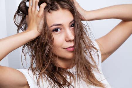 Photo pour Young woman with wet hair after taking a shower - image libre de droit