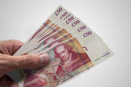 Photo pour British pounds in hand. Several banknotes of United Kingdom - image libre de droit