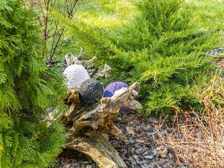Foto für Balls of thread on a green flowerbed of a public park. Decor flower beds. Background image. Place for text. Hand mei. Handwork. Decoration. - Lizenzfreies Bild