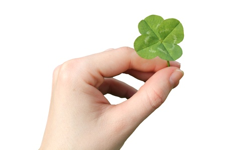 Hand with a four-leaf clover isolated