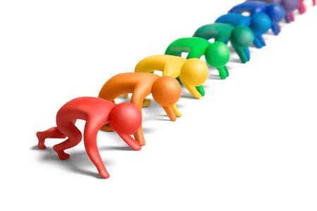 Multicolored  plasticine human figures on a starting line