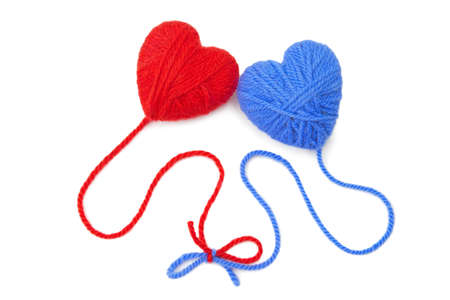 Multicolored wool hearts on white background
