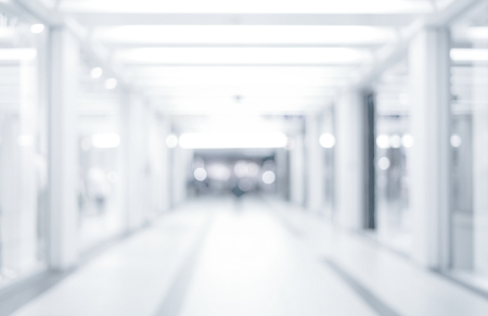 Photo pour abstract defocused blurred background, empty business corridor or shopping mall. Medical and hospital corridor defocused background with modern laboratory clinic - image libre de droit