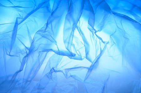 Foto de Abstract background of folds of thin plastic, gradient blue color. - Imagen libre de derechos
