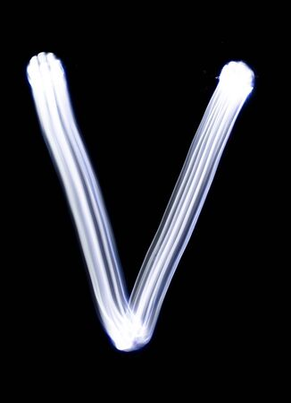 Photo pour Handwrite letter V, made with light painting technic isolated on black. Light effect font of full alphabet set of upper case letters. - image libre de droit