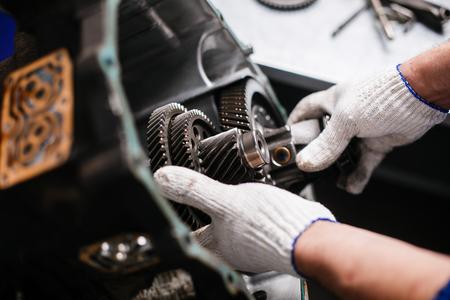Photo pour Cross-section of a car gearbox. mechanics work in the garage. - image libre de droit