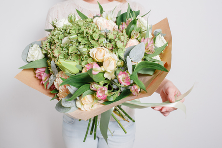 Photo for Florist at work. Make hydrangea rich bouquet. colorful roses - Royalty Free Image