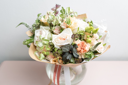 Photo for cute light bouquet with garden roses and mixed flowers on pink table - Royalty Free Image