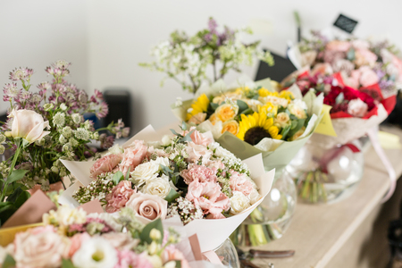 Photo for Bouquets on table, florist business. Different varieties fresh spring flowers. Delivery service. Flower shop concept. - Royalty Free Image