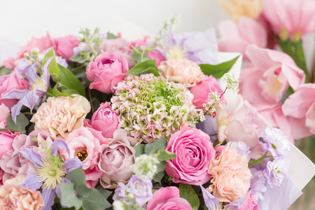 Photo for Close-up beautiful luxury bouquet of mixed flowers in glass vases. the work of the florist at a flower shop. Wallpaper - Royalty Free Image