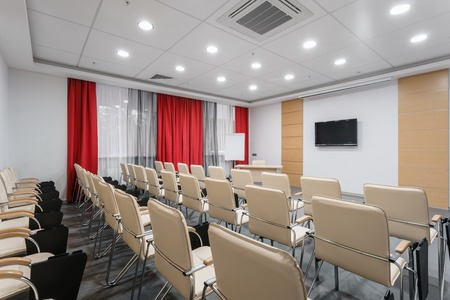 Empty modern conference hall in new hotel. Room for training, education, group classes, exams. Audience for Speakers at Business convention and Presentation.