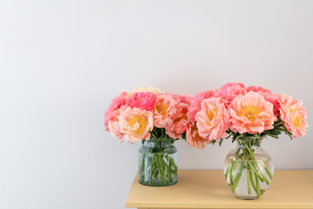 Photo for Coral peonies in a glass vase. Beautiful peony flower for catalog or online store. Floral shop concept . Beautiful fresh cut bouquet. Flowers delivery. - Royalty Free Image