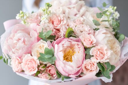 Photo for Two Small Beautiful bouquets of mixed flowers in woman hand. Floral shop concept . Beautiful fresh cut bouquet. Flowers delivery - Royalty Free Image