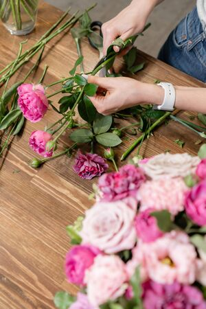Photo for Woman florist create flower arrangement in a wicker basket. Beautiful bouquet of mixed flowers. Floral shop concept . Handsome fresh bouquet. Flowers delivery - Royalty Free Image