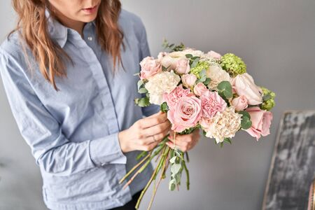 Photo for Education in the school of floristry. Master class on making bouquets. Summer bouquet. Learning flower arranging, making beautiful bouquets with your own hands. Flowers delivery. - Royalty Free Image