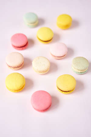 French cake macaron. Set of cute sweets on pastel pink background. almond cookies, pastel colors, top view