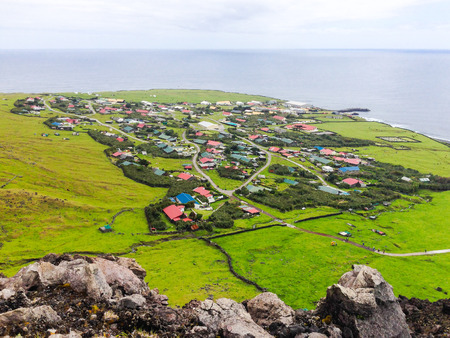 Photo pour Edinburgh of the Seven Seas town aerial panoramic view, Tristan da Cunha, the most remote inhabited island, South Atlantic Ocean, British Overseas Territory. - image libre de droit