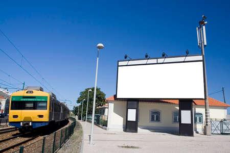 Giant white billboard near trainstation