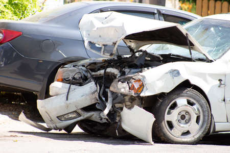 Photo pour A road accident, a car that crashed, a white car on the road, cracks in the glass and a damaged bumper. - image libre de droit