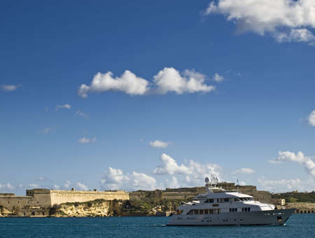 A pleasure vessel enters the Grand Harbour in Malta