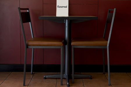 Reserved restaurant table for two.