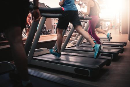 Foto de People running in machine treadmill at fitness gym club - Imagen libre de derechos