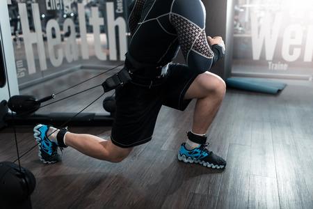 Photo pour Man working fitness sport on kinesis technology machine - image libre de droit