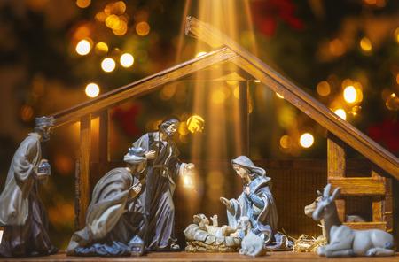 Foto de Christmas Manger scene with figurines including Jesus, Mary, Joseph, sheep and wise men. Focus on baby! - Imagen libre de derechos
