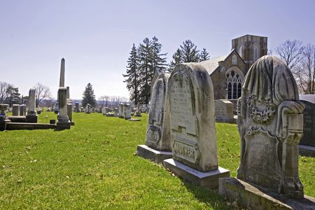 Wide view of the cemetery in the forground with the memorial chapel