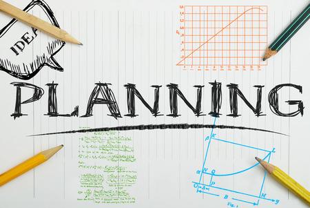 Foto de paper notebook with inscription planning, business concept - Imagen libre de derechos