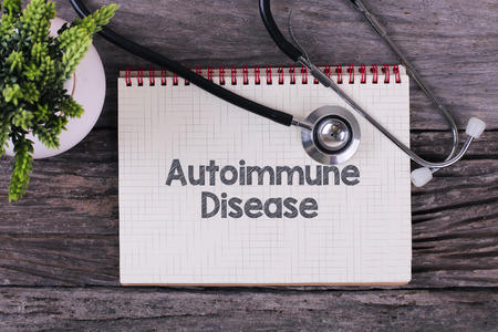 Autoimmune Disease word on notebook,stethoscope and green plan