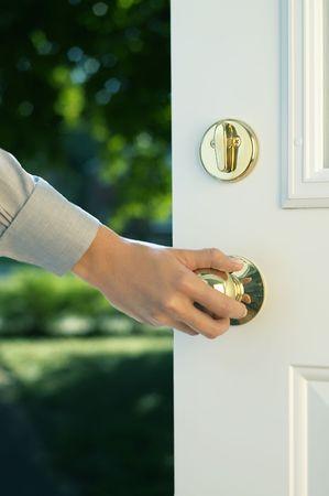 Woman hand opening door