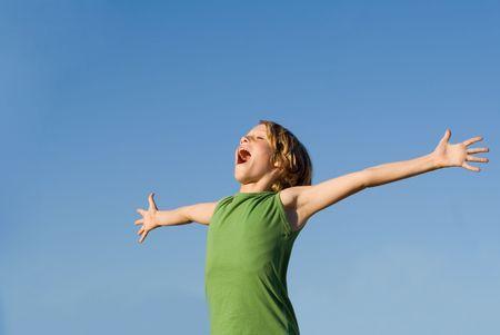 happy child singing or shouting for joy