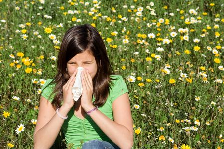 child blowing nose of sneezing with hayfever allergy