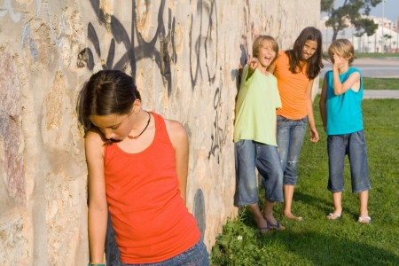 group of kids bullying another child