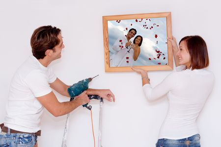 putting up picture in frame(photo in frame is mine of same couple9