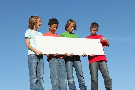 group of diverse kids with blank sign