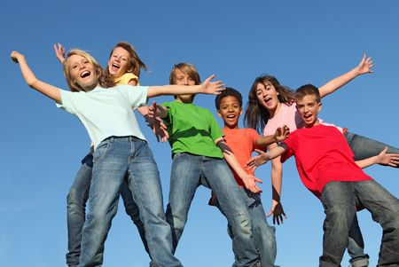 group of diverse kids with arms outstretched