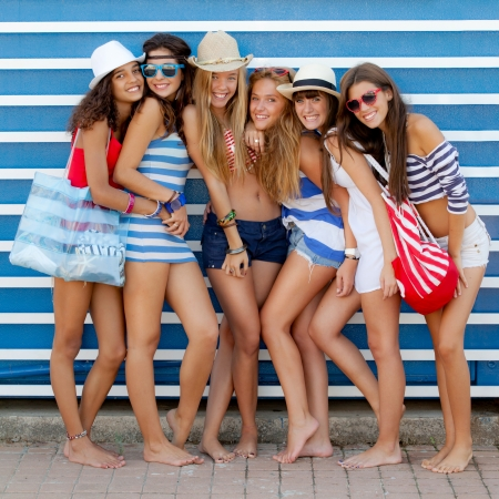 diverse group of girls going to beach on summer vacation