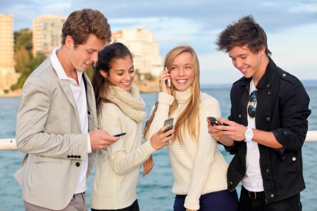 young people or couples with cell or mobile phones