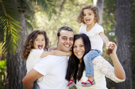 parents and children, happy smiling hispanic family