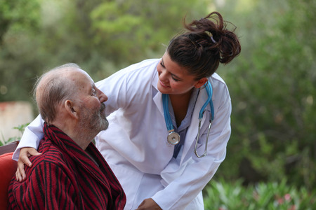 smiling Doctor caring for patient