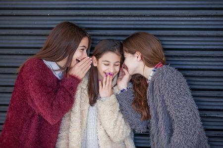 Photo pour group kids giggling whispering secrets - image libre de droit