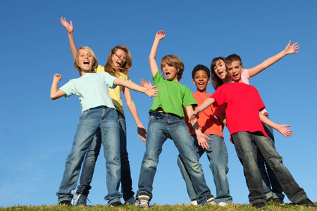 Photo for diversity kids or childrens group hands raised - Royalty Free Image