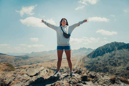 Photo pour Happy 20-year-old girl on top of a mountain in Andorra. - image libre de droit
