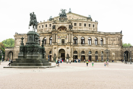 DRESDEN, GERMANY - SEPTEMBER 4: Tourists at the Semperoper in Dresden, Germany on September 4, 2014. The opera house has a long history of premieres, including major works by Richard Wagner and Richard Strauss. Foto taken from Theaterplatz.