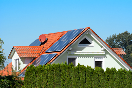 Photo for Modern house with photovoltaic solar cells on the roof for alternative energy production - Royalty Free Image