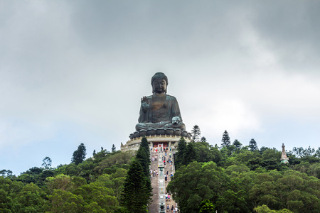 Tian Tan Buddha aka the Big Buddha is a large bronze statue of a Sakyamuni Buddha and located at Ngong Ping Lantau Island in Hong Kong.